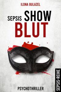 Das Cover des Titels Show Blut von unserer Autorin des Monats Ilona Bulazel. Es zeigt eine schwarze Maske. Dahinter rote Spritzer.